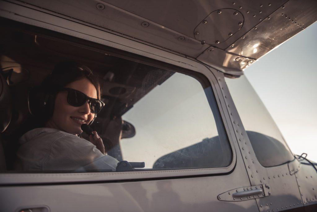 Woman-pilot in aircraft